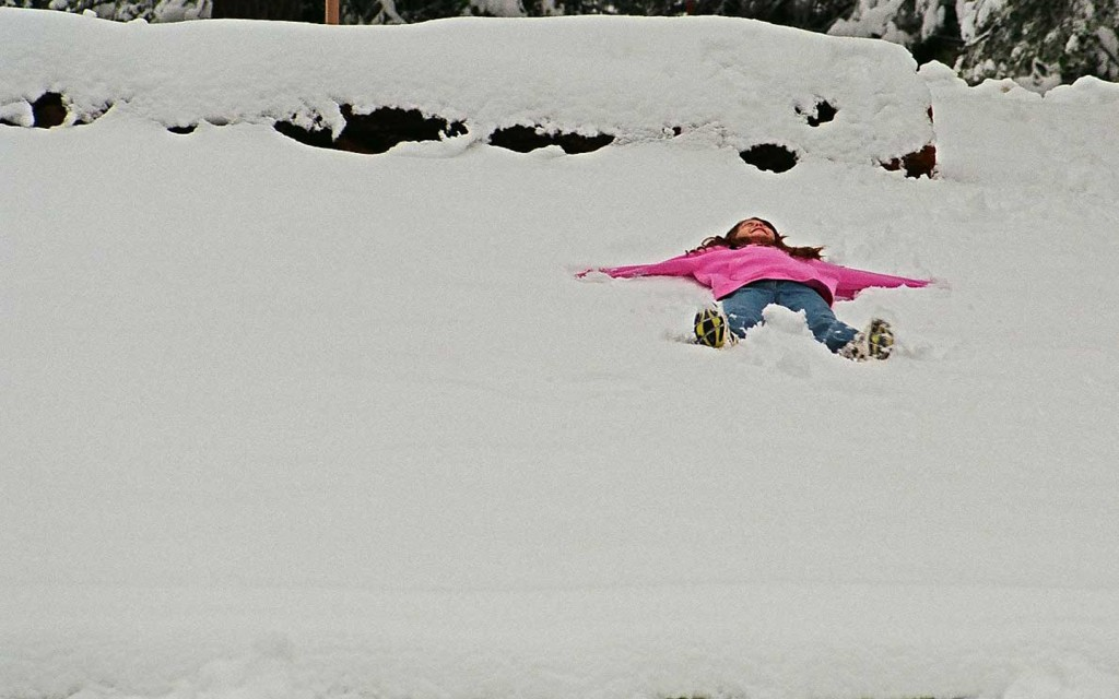 Maya begins a snow angel